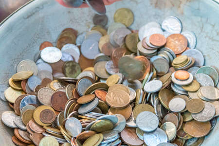 Old antique coins on display in antique shop Stok Fotoğraf