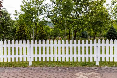 Wooden white fences around the garden Imagens