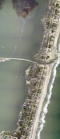 Aerial view showing a portion of the New Jersey coastal town of Mantoloking, just north of where Hurricane Sandy made landfall. On the barrier island, entire blocks of houses along Route 35 (also called Ocean Boulevard) were damaged or completely washed a