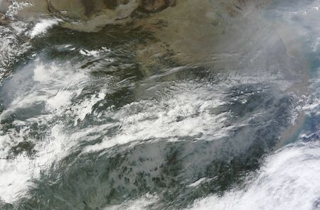 differs: November 4, 2010 - Haze continues to cloud the skies over eastern China. Haze fringes an east-west cloudbank that ends at Shanghai, and extends northward past the city of Yancheng. A thick band also appears in the west, and differs from the nearby clouds