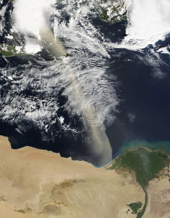 February 23, 2011 - A dust plume stretches across the Mediterranean Sea, from just west of the Nile Delta to just east of Kriti (Crete). The dust plume extends hundreds of kilometers across the ocean, mingling with clouds in the north. Source points for t