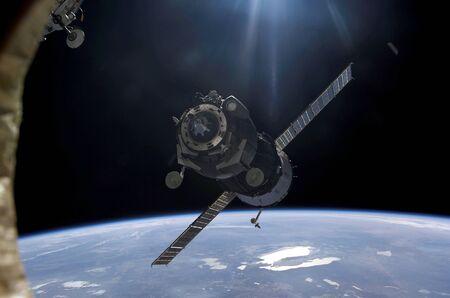 orbiting: Satellite orbiting around Earth LANG_EVOIMAGES