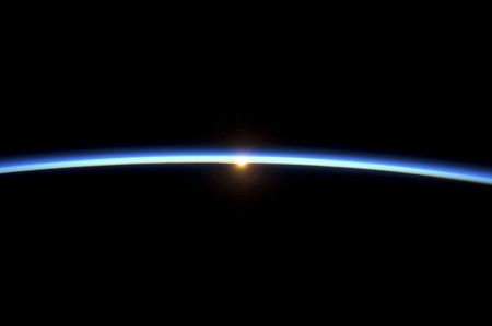 atmosphere: The thin line of Earths atmosphere and the setting sun