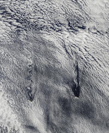 vortices: Clouds over the Juan Fernandez Islands form into vortices LANG_EVOIMAGES