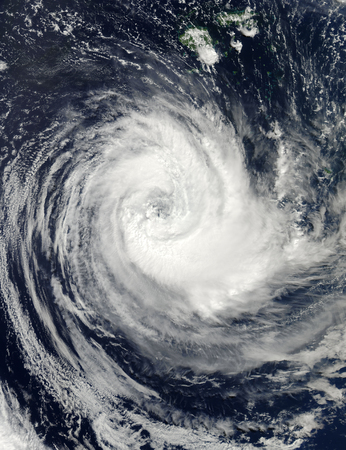 March 27, 2011 - Tropical Cyclone Bune spread over the Southern Pacific Ocean approximately 345 nautical miles south-southeast of Nadi, Fiji, whipping the waters beneath the spiral bands with heavy wind and rain. The storm possesses a very distinct eye, a