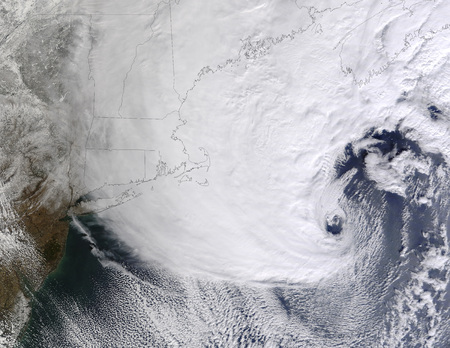 spanned: February 17, 2013 - A winter storm over eastern New England. Storm clouds spanned several hundred kilometers over the Atlantic Ocean and eastern New England. Although clouds were thick over Maine, they thinned in the south, only extending as far south as