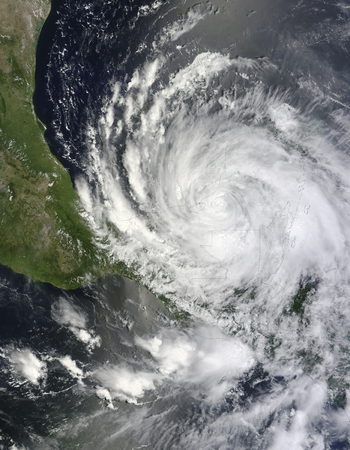August 8, 2012 - Hurricane Ernestos spiral arms extend over southeastern Mexico, Guatemala, and Belize.