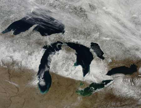 michigan snow: March 28, 2011 - The bright white remnants of snow cut a clean swath across Wisconsin and Michigan during springtime snowmelt. Snow depth in most of the snow-covered swath ranged from 4 inches to 20 inches on the day this image was captured.