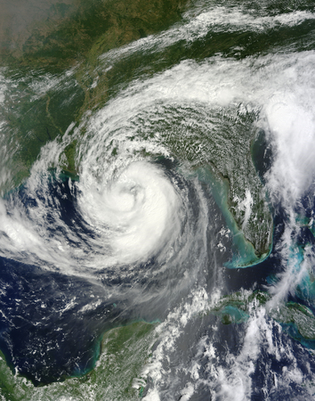 August 28, 2012 - Tropical Storm Isaac moving northwest through the Gulf of Mexico. Issacs large reach is seen by its eastern cloud cover over the Gulf of Mexico.