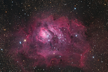 messier: The Lagoon Nebula is a bright, diffuse nebula in the southern constellation Sagittarius; cataloged as M8 or NGC 6526. It contains a number of Bok globules, dark, collapsing clouds of protostellar material as well as a structure at its center known as the