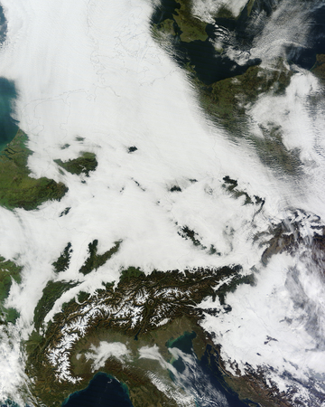 sprawled: November 10, 2011 - A massive cloudbank sprawled over central Europe, with clouds extending from the North Sea to the foothills of the Alps.