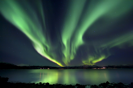 photons: Aurora Borealis over Tjeldsundet in Troms County, Norway. Auroras are the result of the emissions of photons in the Earths upper atmosphere.