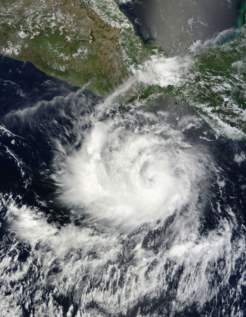 June 23, 2010 - Satellite view of Tropical Storm Darby off the coast of Mexico. The storm narrowly misses the southern coast of Mexico, but one spiral arm extends inland, not far from Puerto Escondido.