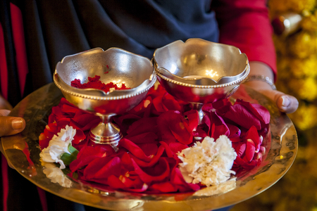 gajra: Woman with flower petals and kumkum