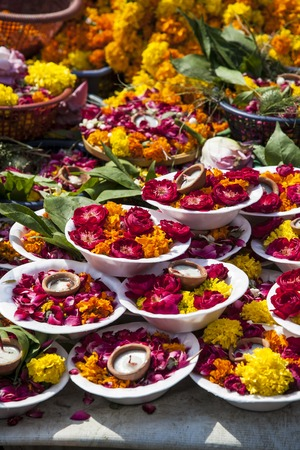 gajra: carpet of colorful plates of flowers and candles