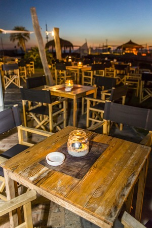external ambient to relax in the poolside restaurant bar at sunset photo