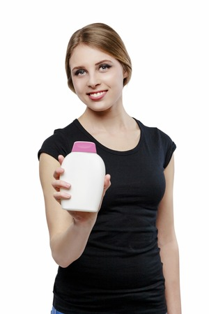 beautiful girl with bottle of soap isolated on white photo
