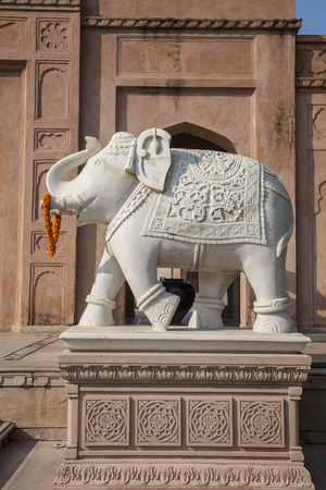beautiful indian gardens with fountain and elephant sculpture photo