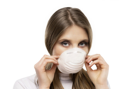 beautiful girl with protective mask  on white background
