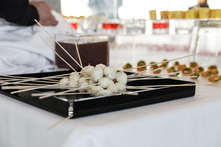 a buffet with fish balls with toothpicks photo