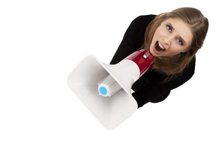 girl with megaphone isolated on a white background photo