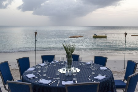 table set for dinner on the beach in miami photo