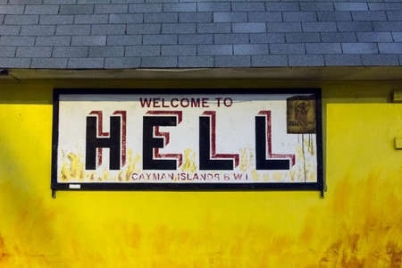 grand cayman, yellow signboard for hell Banco de Imagens