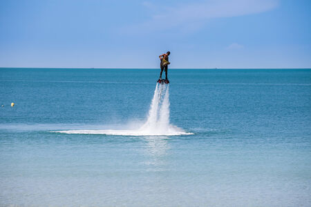 man exibition on flyboard in the thailand beach Stok Fotoğraf