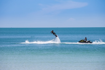 man exibition on Flyboard in the thailand beach photo