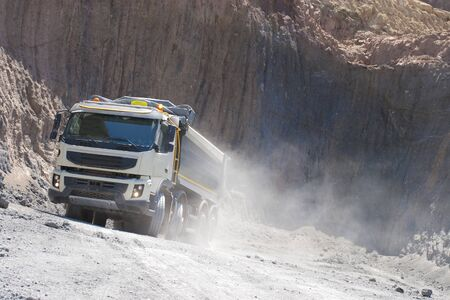Truck and bulldozer work in the quarry Standard-Bild