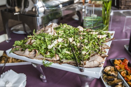 banqueting: plate of sliced ??roast beef with rocket and parmesan
