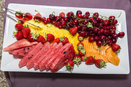 banqueting: plate of fresh fruit with watermelon cherries strawberries and melon Stock Photo