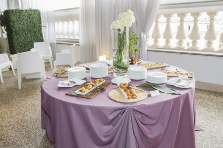 banqueting: catering table set with appetizers and snacks