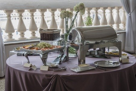 end of a long day: catering table set with appetizers and snacks