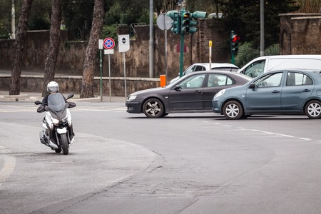 joyride: scooter on the city road with helmet
