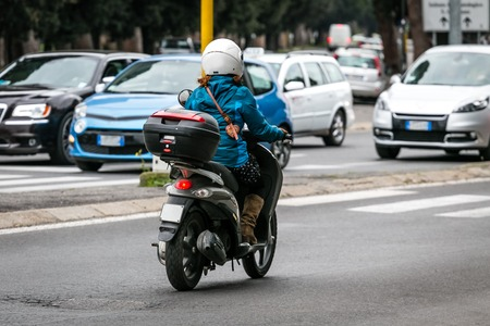 scooter on the city road with helmet4
