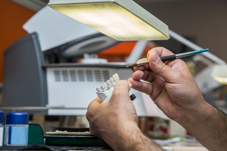 Dental laboratory manufacturing dental prostheses