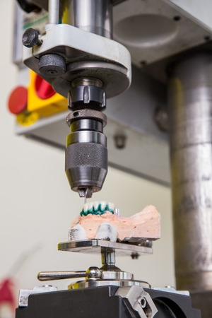 articulator: Dental laboratory, manufacturing denture,  drill in action Stock Photo