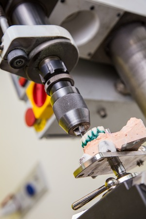 alloys: Dental laboratory, manufacturing denture, drill in action