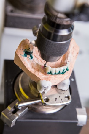dental laboratory: Dental laboratory, manufacturing denture,  drill in action Stock Photo