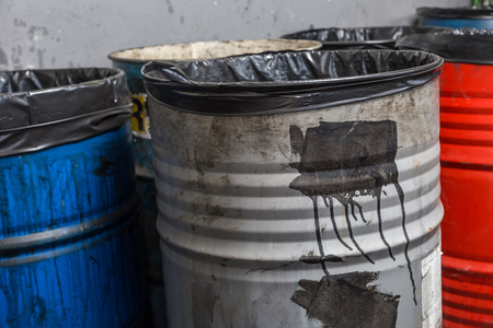 segregate: old bins of oil, used for trash arranged in rows