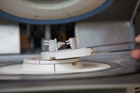 grinding teeth: oven and press for ceramic dental prostheses, in action