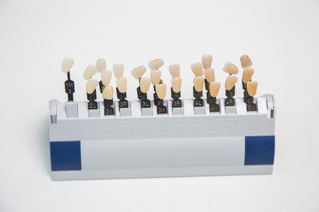 artificial teeth: Closeup of tooth color palette for color matching Choice of color of a artificial tooth, and teeth whitening