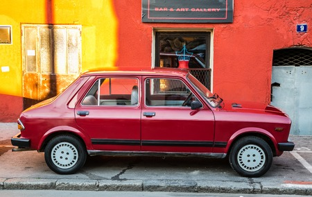old red car parked in belgrade serbia