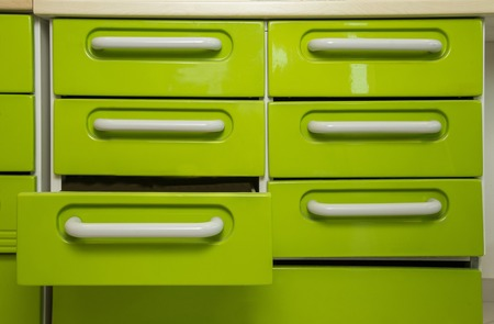 which one: metal drawers in row, of which one is open