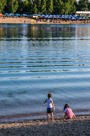 Children playing on the bank of the Sava River in Belgrade Stok Fotoğraf