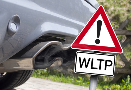Car exhaust with a traffic sign WLTP