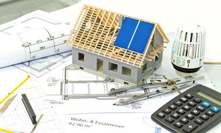 House with a construction plan and solar panel planning Stock Photo