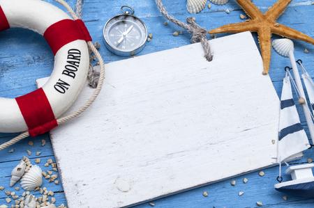 Maritime decoration with shells, starfish, sailing ship, fishing net on blue drift wood Stock Photo