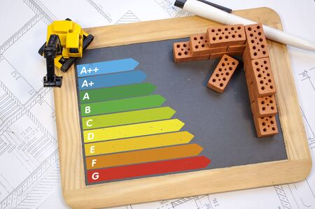 Chalkboard with classes of energy efficiency on a construction plan